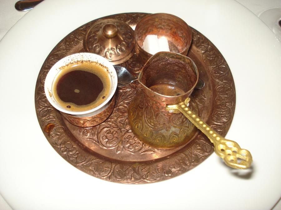 Turkish coffee set  containing a cup of coffee, a coffee pot and a sugar bowl