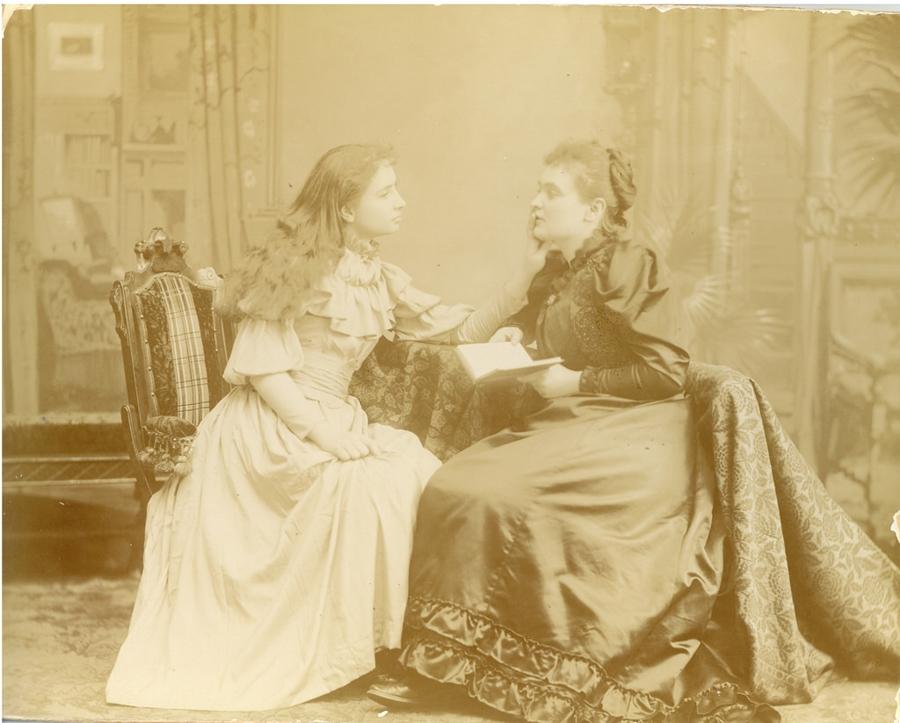 Helen Keller taking a speech lesson from Annie Sullivan